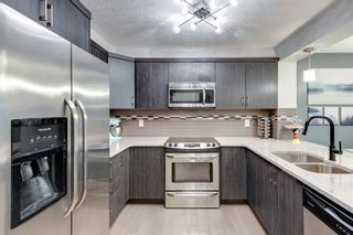 Photo 16: 102 Windford Crescent SW: Airdrie Row/Townhouse for sale : MLS®# A1139546