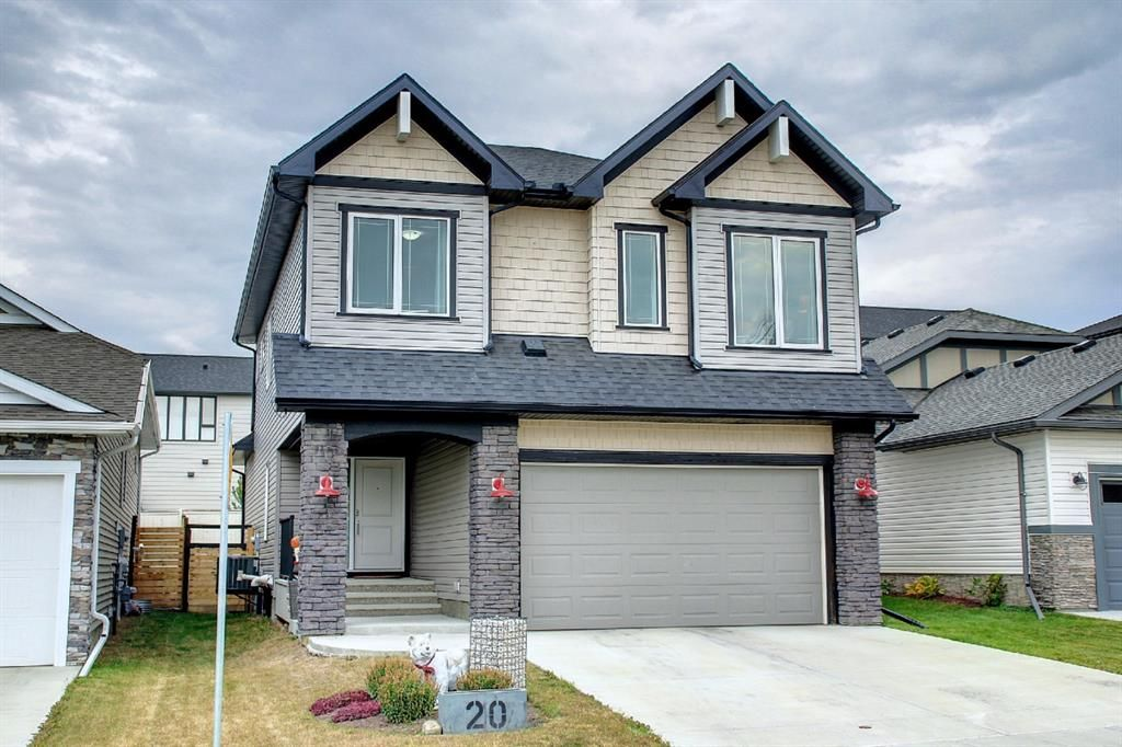 Stunning home with 3-car tandem garage and central A/C in the community of Drake Landing, Okotoks.