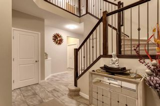 Photo 2: 144 Cougar Ridge Manor SW in Calgary: Cougar Ridge Detached for sale : MLS®# A1098625