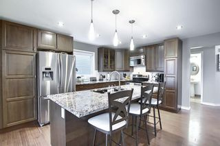 Photo 2: 105 Arbour Ridge Heights NW in Calgary: Arbour Lake Detached for sale : MLS®# A1043840