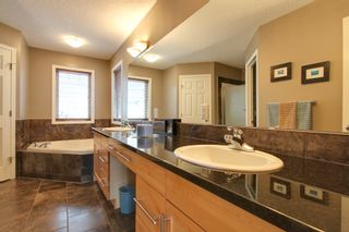 Photo 13: 131 Cougar Plateau Circle SW in Calgary: 2 Storey for sale : MLS®# C3614218