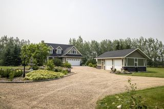 Photo 1: Private Treed Acreage in the City of Airdrie