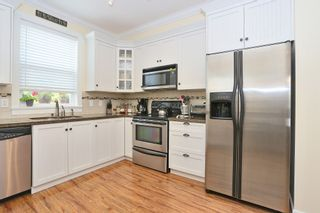"""Photo 6: 21 15075 60TH Avenue in Surrey: Sullivan Station Townhouse for sale in """"NATURES WALK"""" : MLS®# F1446797"""