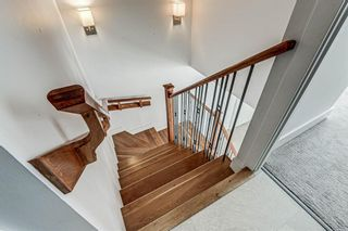 Photo 18: 14609 SHAWNEE Gate SW in Calgary: Shawnee Slopes Row/Townhouse for sale : MLS®# A1010386