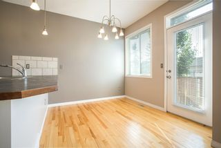 Photo 9: 8 Everridge Gardens SW in Calgary: Evergreen Row/Townhouse for sale : MLS®# A1041120