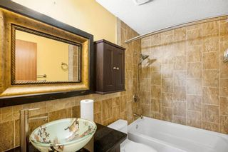Photo 22: 128 Dovertree Place SE in Calgary: Dover Semi Detached for sale : MLS®# A1075565
