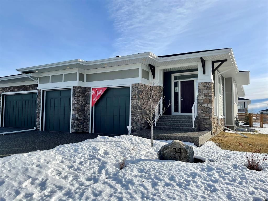 Main Photo: 34 PIPIT Bay in Rural Rocky View County: Rural Rocky View MD Semi Detached for sale : MLS®# A1061217