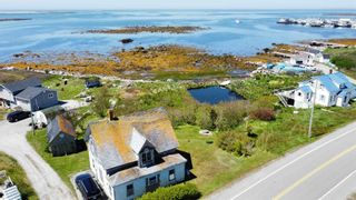 Photo 1: 2844 Main Street in Clark's Harbour: 407-Shelburne County Residential for sale (South Shore)  : MLS®# 202113865