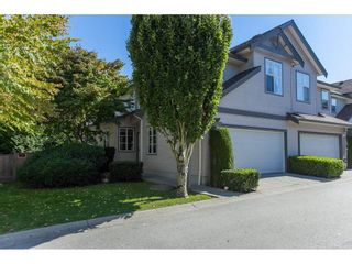 """Photo 1: 67 14468 73A Avenue in Surrey: East Newton Townhouse for sale in """"THE SUMMIT"""" : MLS®# R2110614"""