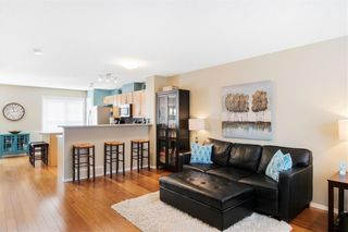 Photo 5: 206 TOSCANA Gardens NW in Calgary: Tuscany Row/Townhouse for sale : MLS®# A1088865