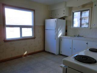Photo 8: 204 CENTRE Avenue: Cochrane House for sale : MLS®# C4055784