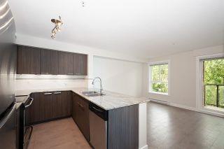 Photo 8: 303 13883 LAUREL Drive in Surrey: Whalley Condo for sale (North Surrey)  : MLS®# R2620513