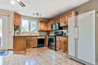 Photo 8: 116 6103 Madigan Drive NE in Calgary: Marlborough Park Row/Townhouse for sale : MLS®# A1111387