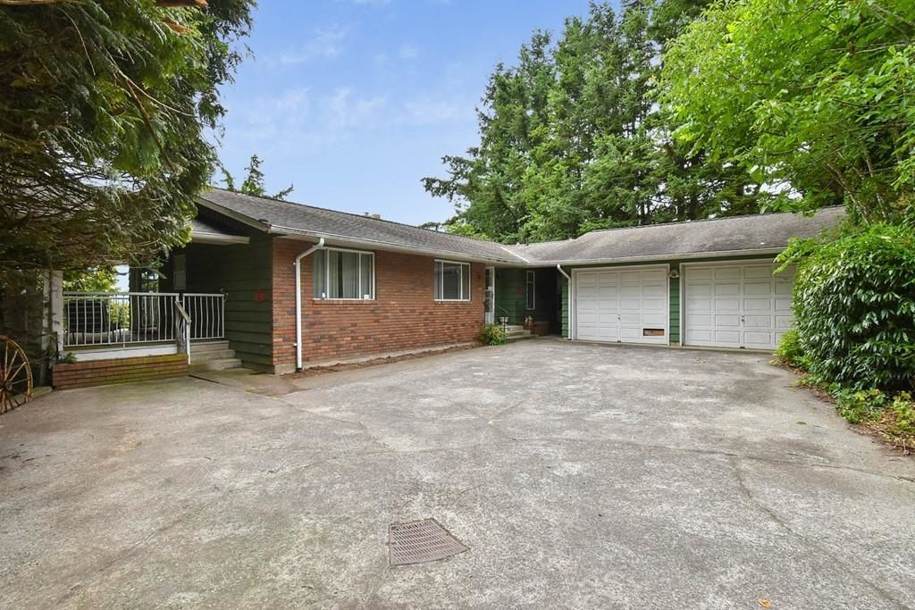 Main Photo: 35176 MARSHALL Road in Abbotsford: Abbotsford East House for sale : MLS®# R2602870