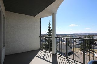 Photo 32: 509 55 ARBOUR GROVE Close NW in Calgary: Arbour Lake Apartment for sale : MLS®# A1096357