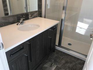 Photo 43: 23 Sunrise Heights: Cochrane Duplex for sale : MLS®# A1017998