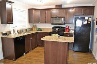 Photo 2: 105 Henick Crescent in Saskatoon: Hampton Village Residential for sale : MLS®# SK727356