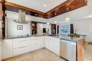Photo 11: 100 Westwood Drive SW in Calgary: Westgate Detached for sale : MLS®# A1057745