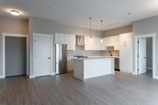 """Photo 4: A605 20838 78B Avenue in Langley: Willoughby Heights Condo for sale in """"Hudson & Singer"""" : MLS®# R2608536"""