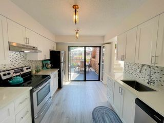 """Photo 8: 405 CARDIFF Way in Port Moody: College Park PM Townhouse for sale in """"EASTHILL"""" : MLS®# R2598640"""