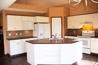 Photo 2: 222 Douglas Ridge Mews SE in Calgary: Douglasdale/Glen Detached for sale : MLS®# A1109207