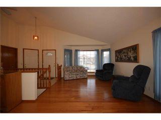 Photo 12: 31 RIVERVIEW Close: Cochrane House for sale : MLS®# C4055630