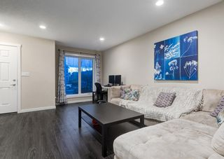 Photo 3: 102 2400 RAVENSWOOD View SE: Airdrie Row/Townhouse for sale : MLS®# A1092501