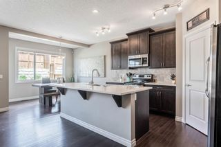 Photo 5: 205 Heritage Boulevard: Cochrane Detached for sale : MLS®# A1122442