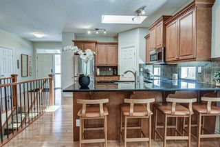Photo 15: 7 ELYSIAN Crescent SW in Calgary: Springbank Hill Semi Detached for sale : MLS®# A1104538