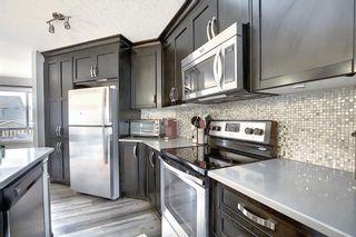 Photo 10: 134 Auburn Crest Way SE in Calgary: Auburn Bay Detached for sale : MLS®# A1061710