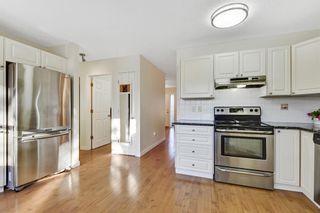 Photo 10: 735 68 Avenue SW in Calgary: Kingsland Semi Detached for sale : MLS®# A1051143
