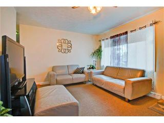 Photo 3: 4232 7 Avenue SW in Calgary: Rosscarrock House for sale : MLS®# C4078756