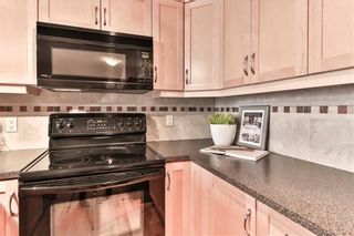 Photo 14: 111 2121 98 Avenue SW in Calgary: Palliser Apartment for sale : MLS®# A1076352