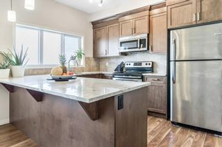 Photo 9: 617 HILLCREST Road SW: Airdrie Row/Townhouse for sale : MLS®# C4306050