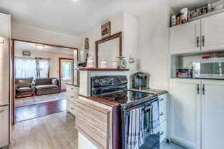 Photo 10: 2221 CLARKE Street in Port Moody: Port Moody Centre House for sale : MLS®# R2611613