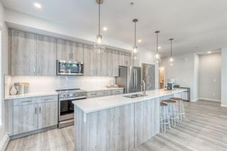 Photo 4: 114 71 Shawnee Common SW in Calgary: Shawnee Slopes Apartment for sale : MLS®# A1099362