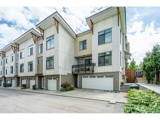 """Photo 1: 97 9989 BARNSTON Drive in Surrey: Fraser Heights Townhouse for sale in """"Highcrest"""" (North Surrey)  : MLS®# R2477034"""