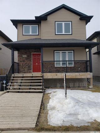 Photo 1: 815 Willowgrove Crescent in Saskatoon: Willowgrove Residential for sale : MLS®# SK845988