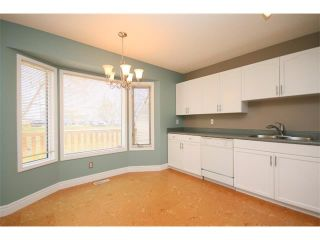 Photo 8: 59 PATINA View SW in Calgary: Prominence_Patterson House for sale : MLS®# C4018191