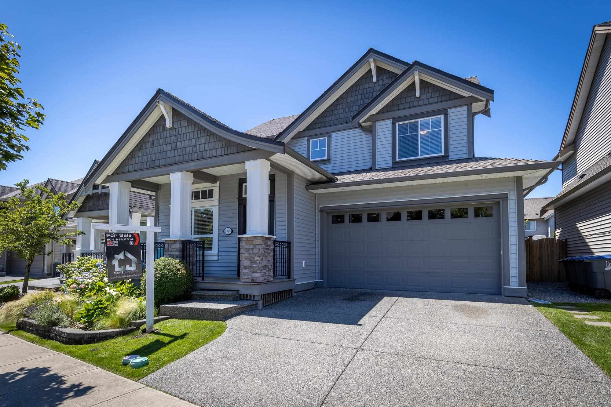 """Main Photo: 7021 195A Street in Surrey: Clayton House for sale in """"Clayton"""" (Cloverdale)  : MLS®# R2594485"""