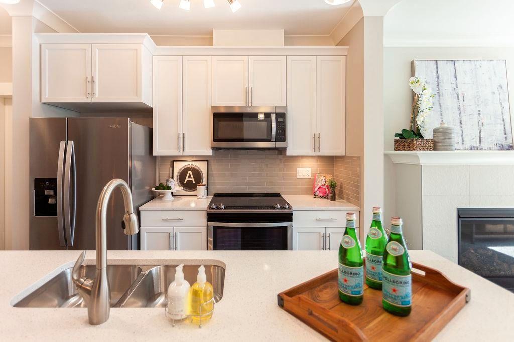 "Main Photo: 112 45761 STEVENSON Road in Chilliwack: Sardis East Vedder Rd Condo for sale in ""Park Ridge"" (Sardis)  : MLS®# R2607807"