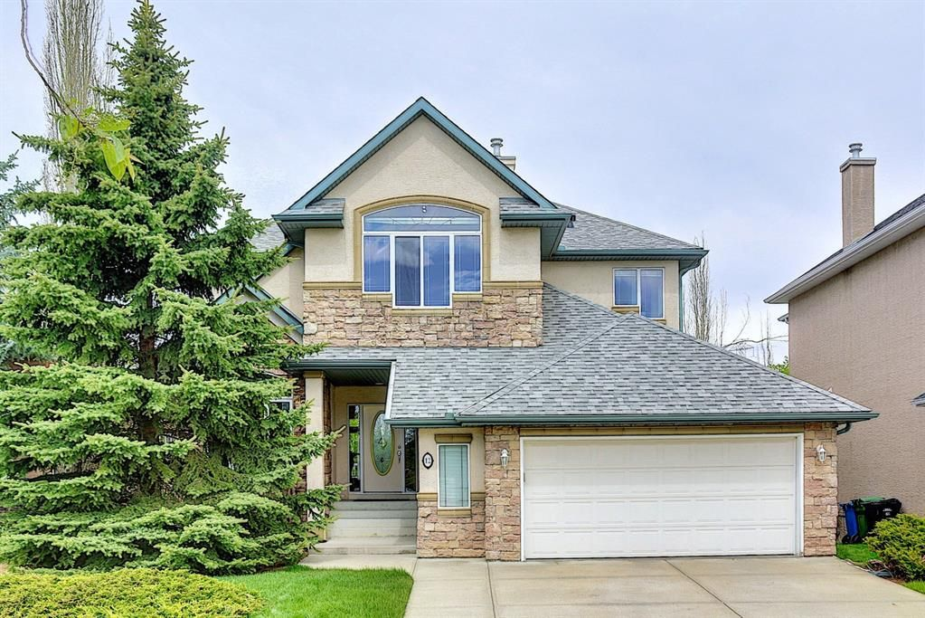 Main Photo: 12 Strathlea Place SW in Calgary: Strathcona Park Detached for sale : MLS®# A1114474