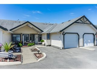 """Photo 1: 106 19649 53 Avenue in Langley: Langley City Townhouse for sale in """"Huntsfield Green"""" : MLS®# R2595915"""