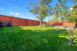 Photo 9: 13719 Deer Run Boulevard SE in Calgary: Deer Run Detached for sale : MLS®# A1039394