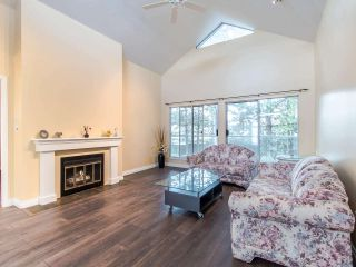 Photo 1: 404 2733 ATLIN PLACE in Coquitlam: Coquitlam East Condo for sale : MLS®# R2419896
