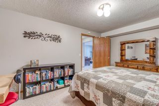 Photo 25: 210 Arbour Cliff Close NW in Calgary: Arbour Lake Semi Detached for sale : MLS®# A1086025