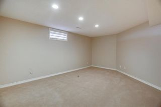 Photo 37: 74 SHAWNEE CR SW in Calgary: Shawnee Slopes House for sale : MLS®# C4226514