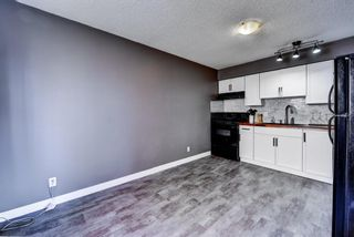 Photo 8: 1 6144 Bowness Road NW in Calgary: Bowness Row/Townhouse for sale : MLS®# A1077373