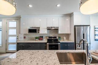 Photo 5: 105 1632 20 Avenue NW in Calgary: Capitol Hill Row/Townhouse for sale : MLS®# A1068096