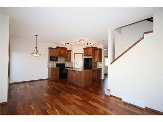 Photo 7: 103 WEST POINTE Court: Cochrane House for sale : MLS®# C4042878